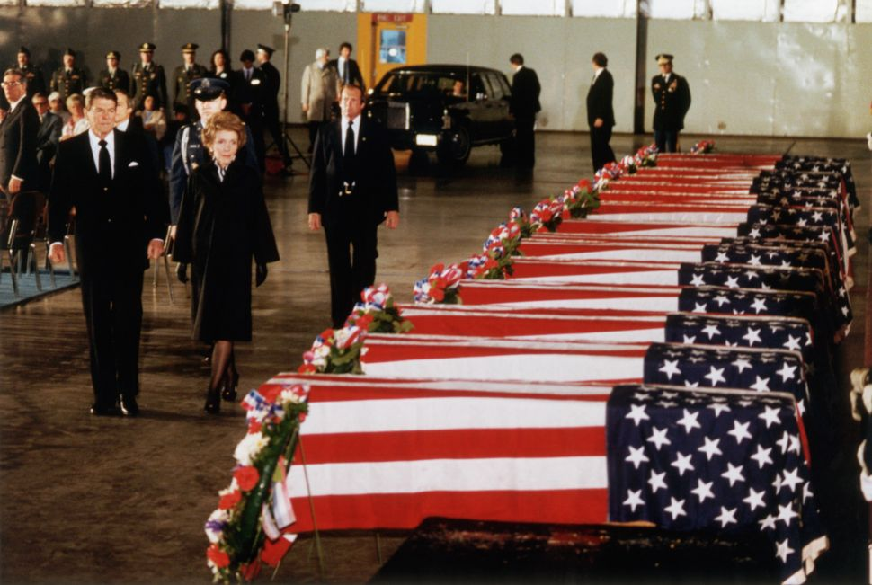 President Ronald and Nancy Reagan view the coffins of victims killed in a bomb explosion at the United States Embassy in Beirut, Lebanon.