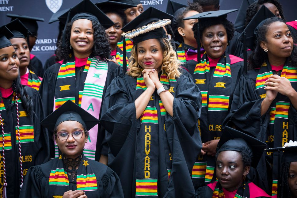 Graduates listen to the master of ceremony as they take part in the Black Commencement at Harvard University on May 23, 2017.