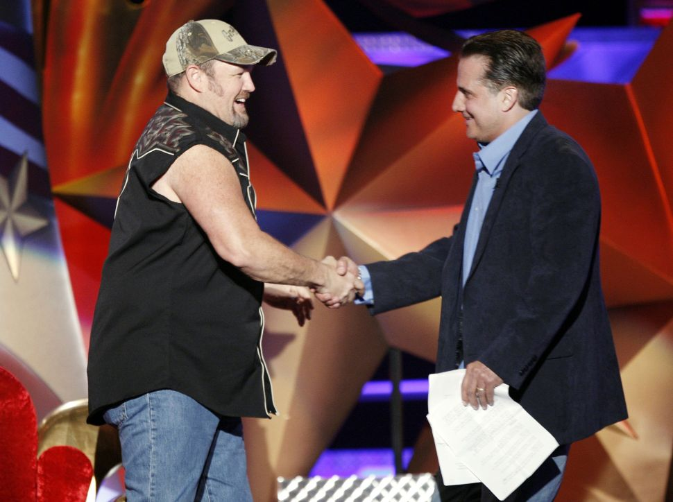 Comedians Larry the Cable Guy (L) and Nick Di Paolo (R) appear onstage at the Comedy Central roast of Larry the Cable Guy on March 1, 2009 in Burbank, California.