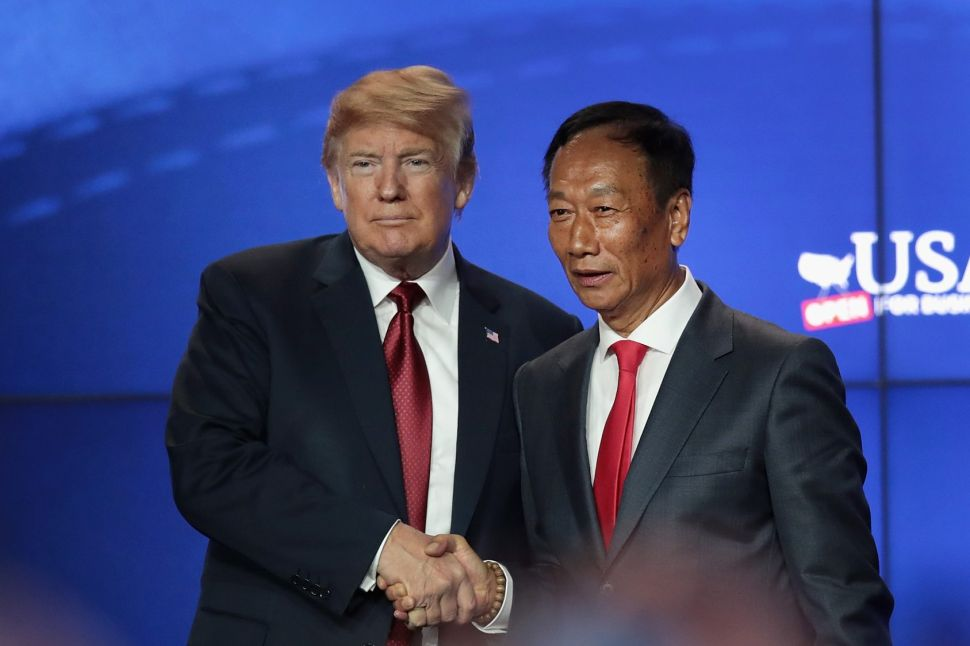 President Donald Trump (L) and Terry Gou, chairman of Foxconn Technology Group, at the groundbreaking ceremony for Foxconns Milwaukee campus in June 2018.