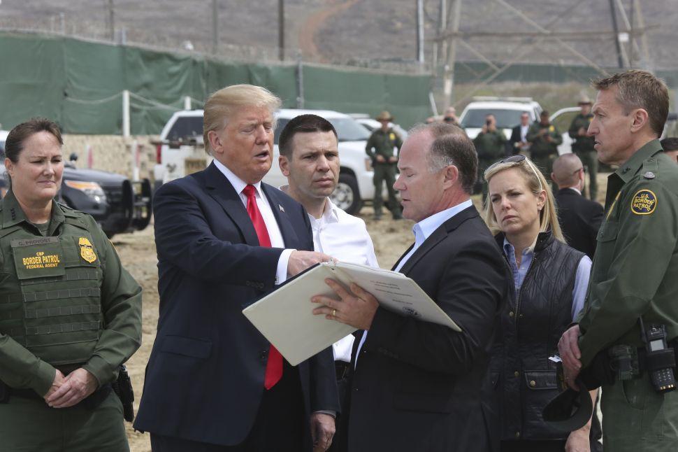President Donald Trump inspects border wall prototypes.