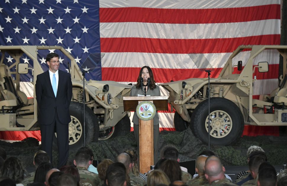 Karen Pence, the wife of U.S. Vice President Mike Pence, speaks alongside U.S. Secretary of the Army Mark Esper.