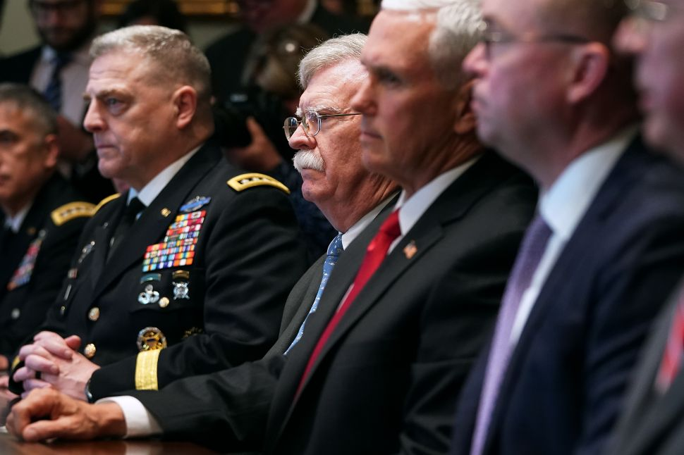 Army Chief of Staff General Mark Milley, National Security Advisor John Bolton, Vice President Mike Pence and Chief of Staff Mick Mulvaney attend a briefing with President Donald Trump and other military leaders in the Cabinet Room at the White House.