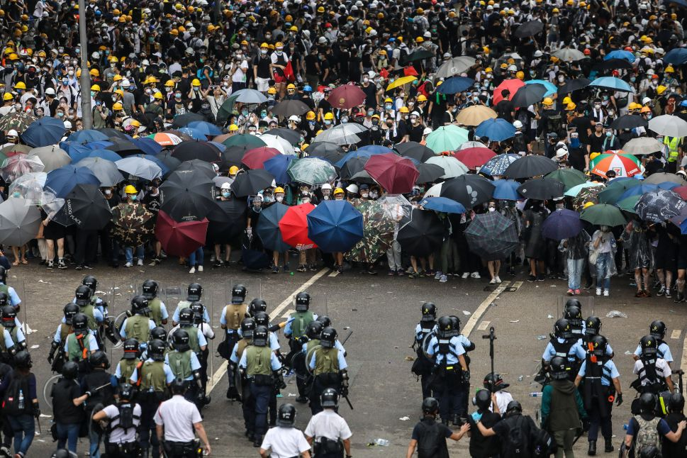 Protesters face off with police during a rally against a controversial extradition law proposal outside government headquarters in Hong Kong on June 12, 2019.