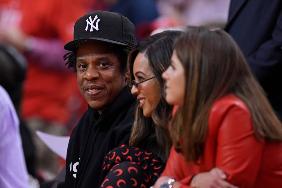Jay-Z and Beyoncé take in a Rockets game in Houston, Texas.