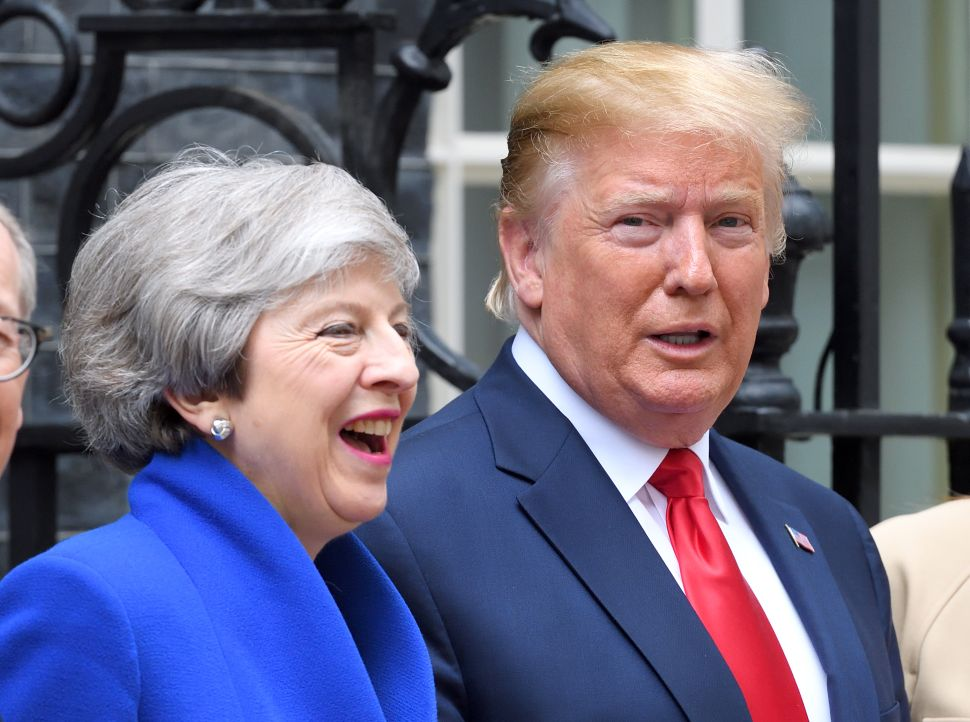 British Prime Minister Theresa May welcomes U.S. President Donald Trump.
