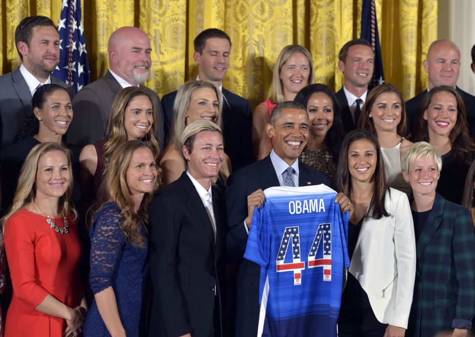 U.S. President Barack Obama poses for group photos with members of the U.S. Women's National Soccer Team during a ceremony to honor them and their victory in the 2015 FIFA Women's World Cup at the East Room of the White House on Oct. 27, 2015.