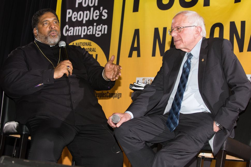 Bernie Sanders speaks with Rev. William Barber at the Poor People's Moral Action Congress at Trinity University in Washington D.C.
