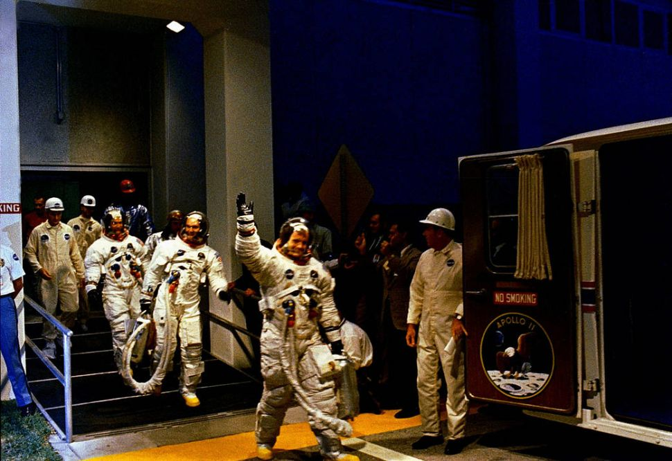 The Apollo 11 crew leaves Kennedy Space Center's Manned Spacecraft Operations Building during the pre-launch countdown.