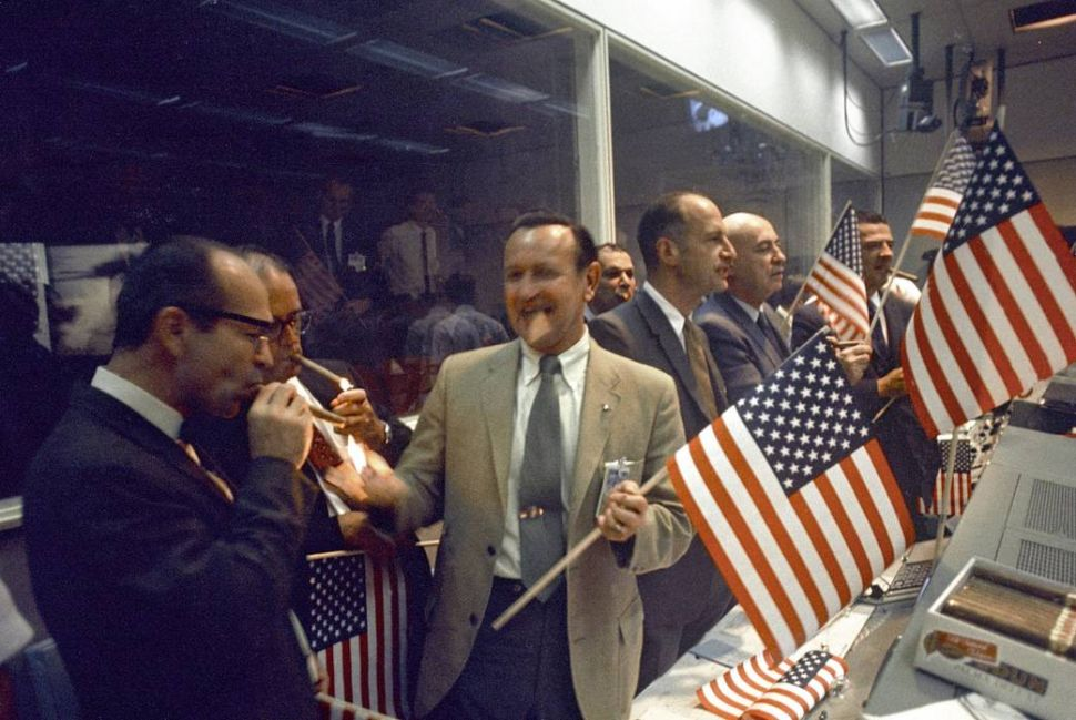 NASA and Manned Spacecraft Center (MSC) officials joined with flight controllers to celebrate the successful conclusion of the Apollo 11 lunar landing mission in the Mission Control Center.