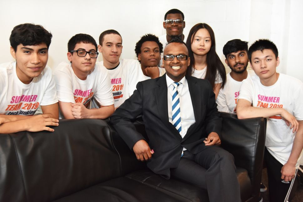 Nelson Nigel, center, founder of Kidmoto Technologies and summer interns at the NYDesigns office in Long Island City, Queens. Interns left to right: Victor Martinez, Sebastian Silguero, Wilber Garcia, Jaydon Felix, Kyle Smith, Shelly Lin, Nur Mazumder and Jack Wang