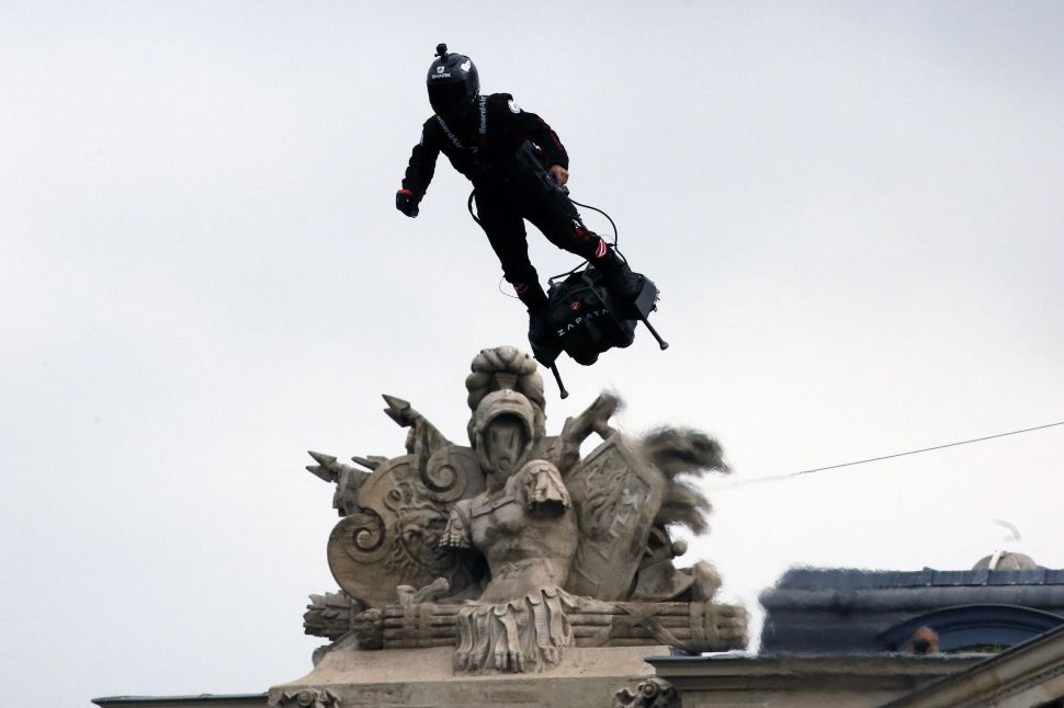 Franky Zapata, a French inventor and entrepreneur, flies a jet-powered hoverboard during the annual Bastille Day military parade in Paris, France on July 14, 2019.