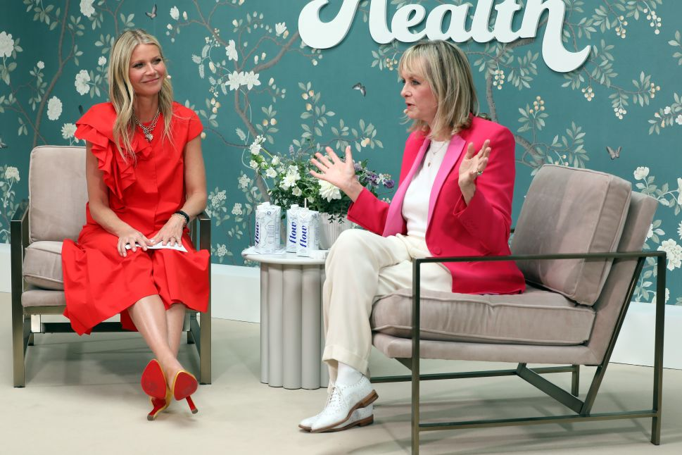 Gwyneth Paltrow chatting with Twiggy on the London Goop stage.