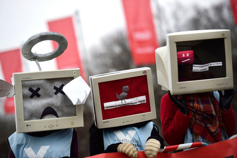Protesters against internet censorship, wearing computers as helmets, are seen on March 15, 2015 in Hanover, Germany.