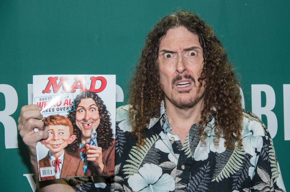 Singer Weird Al Yankovic signs copies of Mad magazine's issue #533 at Barnes & Noble Union Square on April 20, 2015 in New York City.