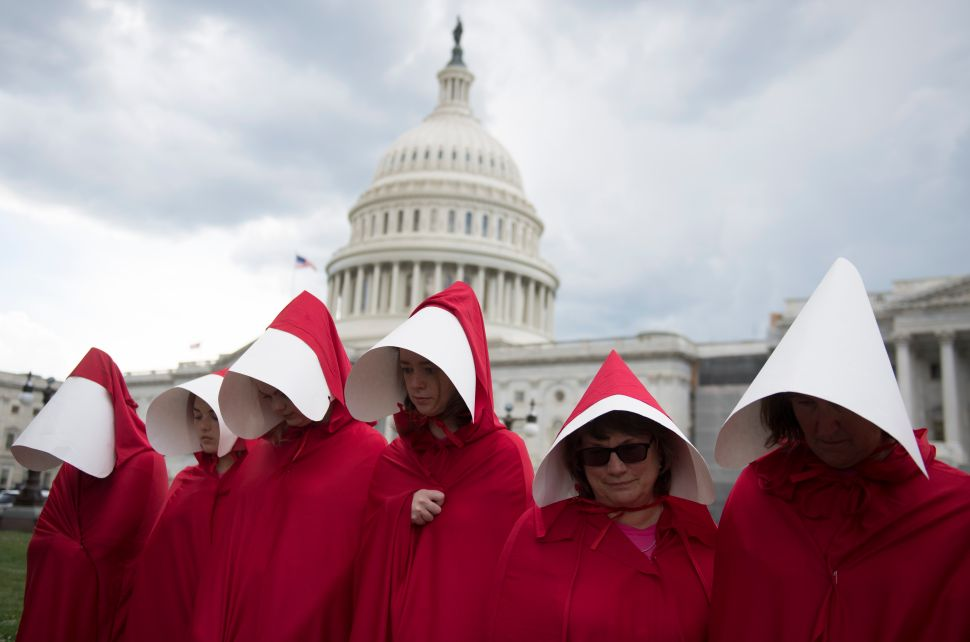 Supporters of Planned Parenthood dressed as characters from 'The Handmaid's Tale' hold a rally as they protest the U.S. Senate Republicans' health care bill outside the U.S. Capitol on June 27, 2017.