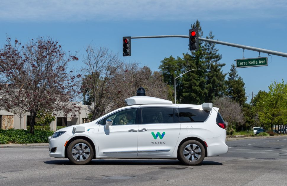 A Chrysler Pacifica minivan retrofitted with the Waymo self-driving system.