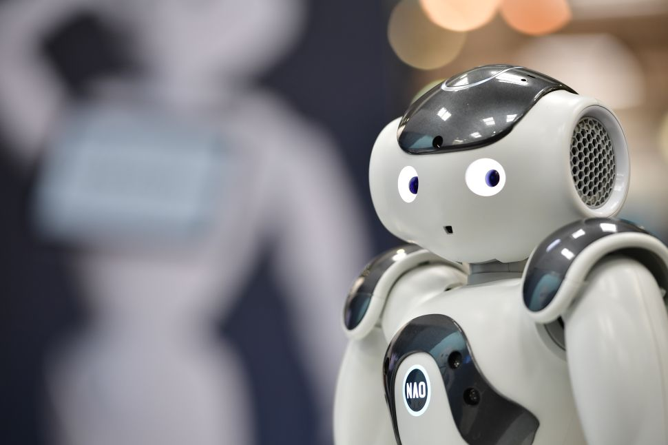 NAO, the first built humanoid robot, entertains visitors at the SoftBank Robotics stand at the 2018 CeBIT technology trade fair on June 12, 2018.