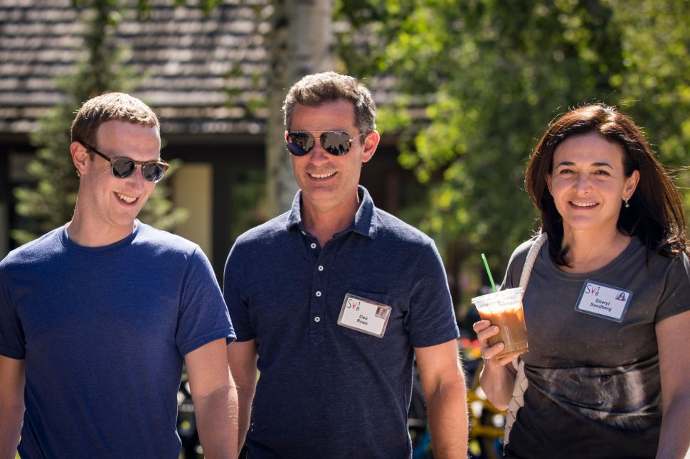 Facebook CEO Mark Zuckerberg (L), head of partnership Dan Rose (M) and COO Sheryl Sandberg at the annual Allen & Company Sun Valley Conference