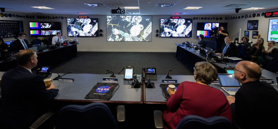 NASA administrator Jim Bridenstine, NASA management and members of Congess watch the beginning of the first all-woman spacewalk on Friday, Oct. 18, 2019, from the Space Operations Center at NASA headquarters in Washington.