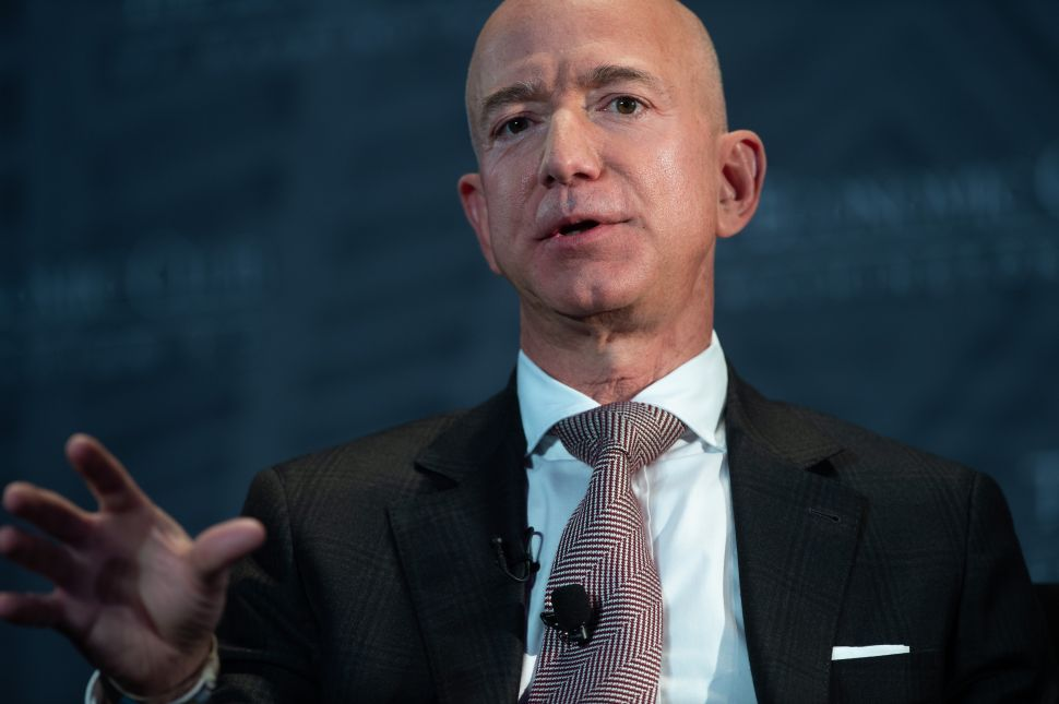 Amazon CEO Jeff Bezos says investing in one-day shipping has been beneficial to customers.