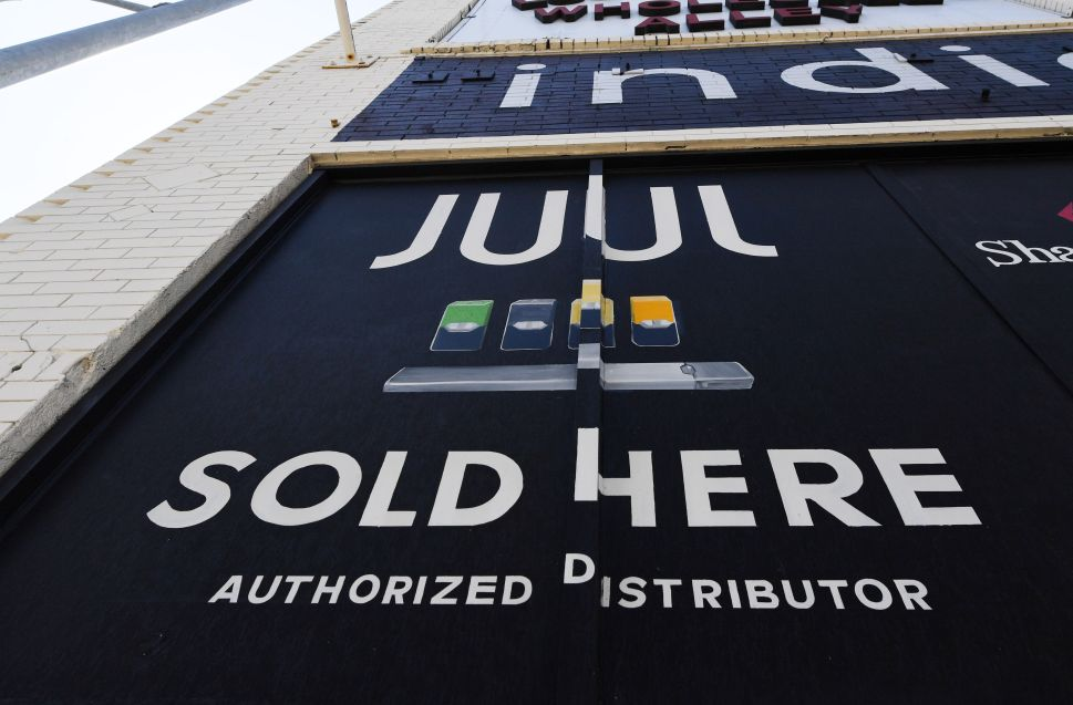 A sign advertises Juul vaping products in Los Angeles, Calif.