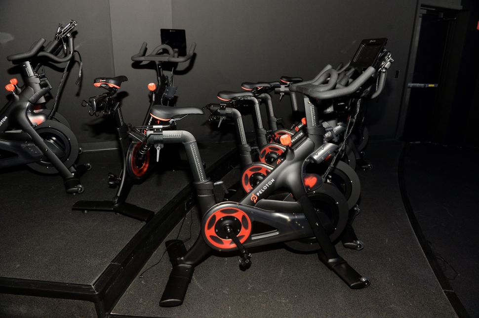 Peloton's flagship spin studio in NYC, featuring its famous red and black bikes.