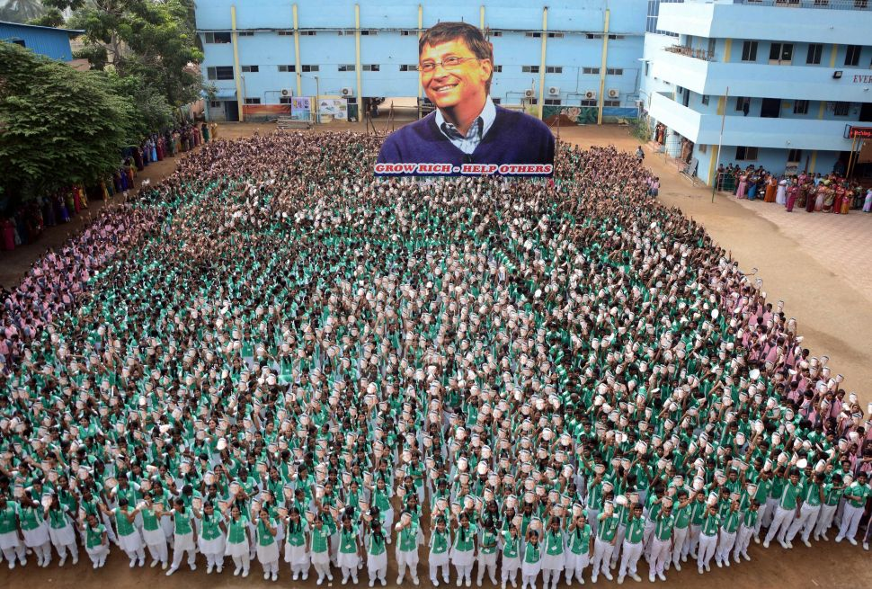 About 5,000 Indian schoolchildren hold up a cutout of Bill Gates to mark his 60th birthday at a school in Chennai on October 28, 2015.