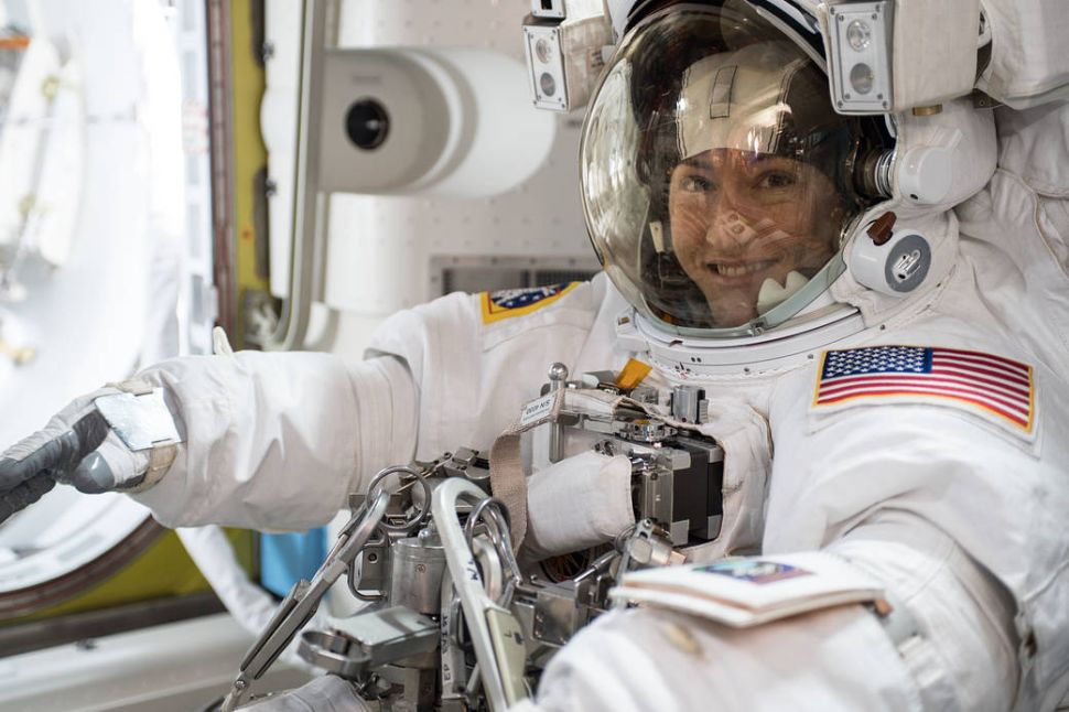 NASA astronaut Christina Koch is suited up in a U.S. spacesuit before beginning a seven hour and one minute spacewalk.