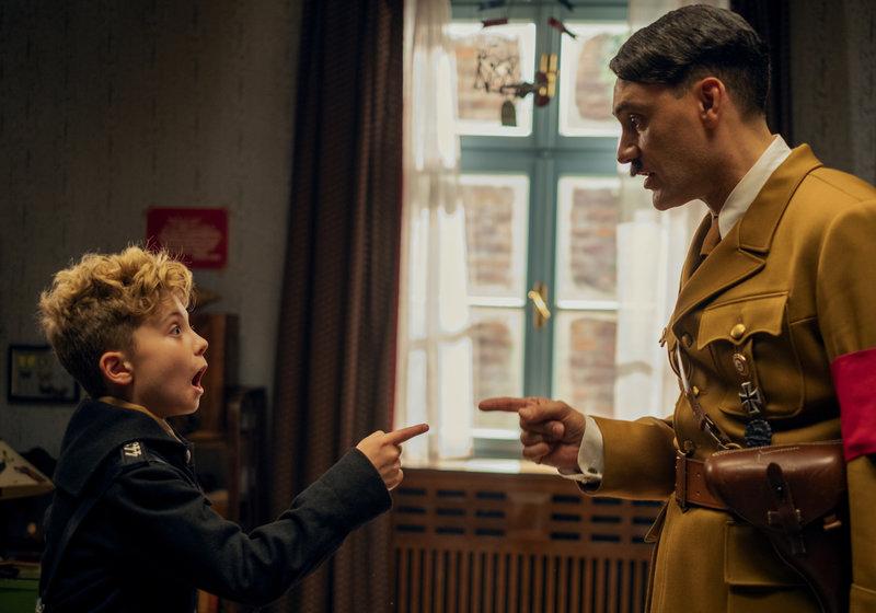 Roman Griffin Davis and Taika Waititi in JoJo Rabbit.