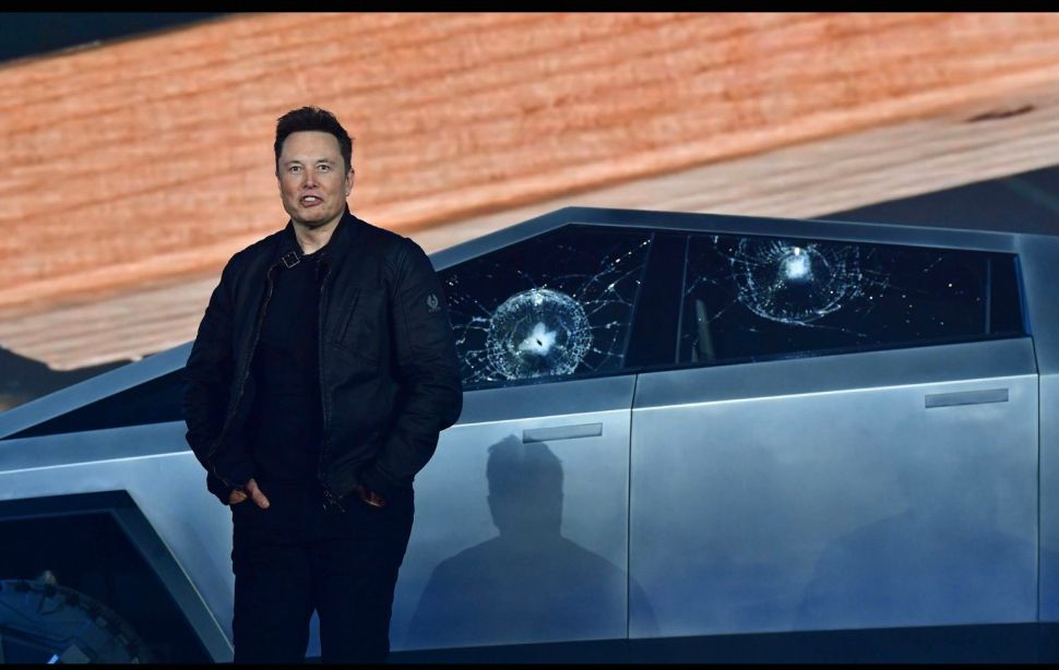 "Elon Musk stands in front of the Cybertruck after its ""unbreakable"" windows were shattered by a metal ball."
