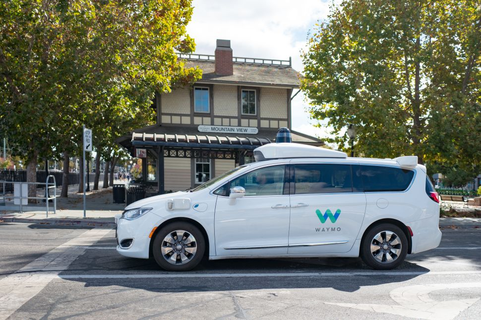 A driverless Chrysler Pacifica minivan operated by Waymo's LIDAR and other sensor units cruise on the roads in Mountain View, Calif.