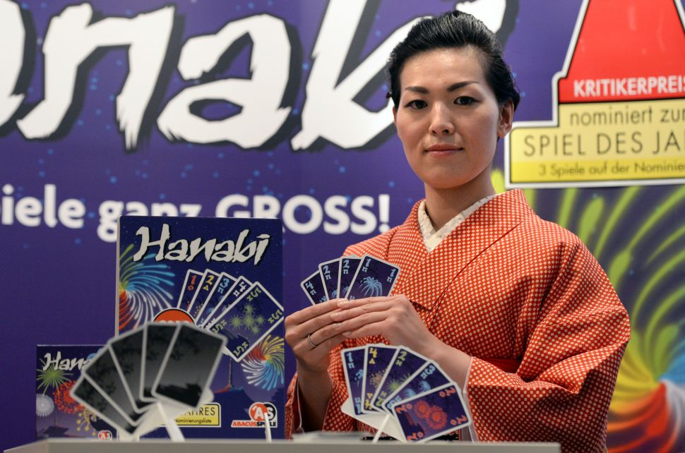 The card game Hanabi features collaboration among players and decision making based on incomplete information.