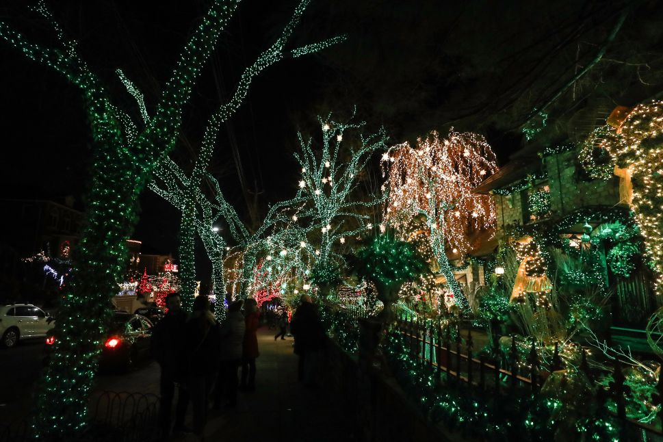 Christmas lights and other ornaments are viewed outside of a home in Dyker Heights, a neighborhood of Brooklyn.