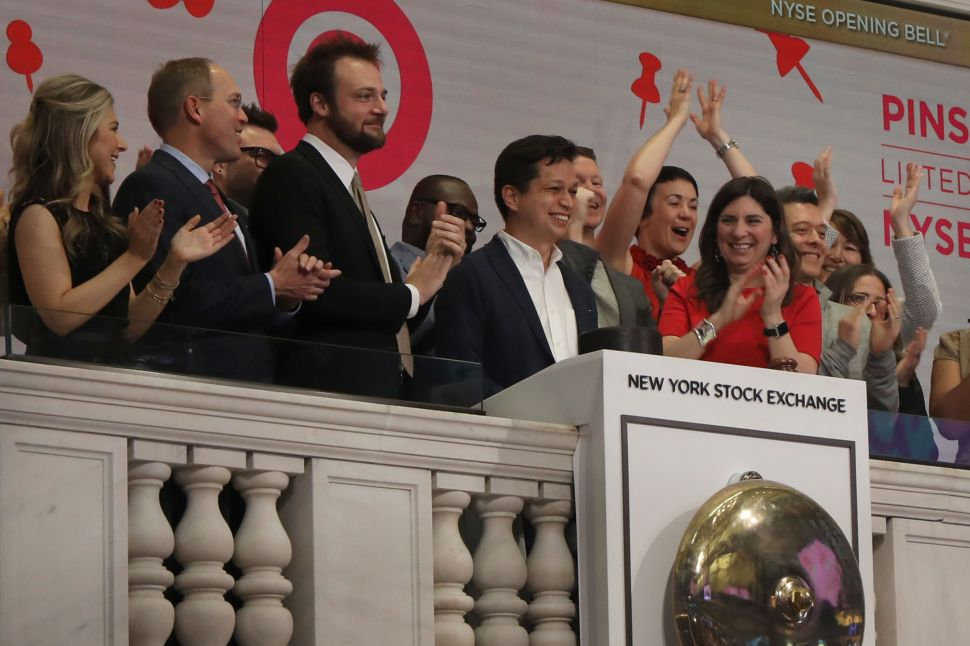 Pinterest CEO Ben Silbermann (center) and his coworkers ring the opening bell at the NYSE on April 18, 2019.