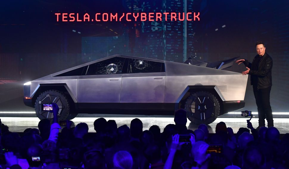 Tesla CEO Elon Musk gestures while wrapping up his presentation of the all-electric Tesla Cybertruck at the Tesla Design Center in Hawthorne, California on November 21, 2019.