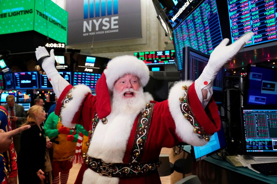 Santa Claus gestures on the floor at the closing bell of the Dow Industrial Average at the New York Stock Exchange on December 5, 2019 in New York.
