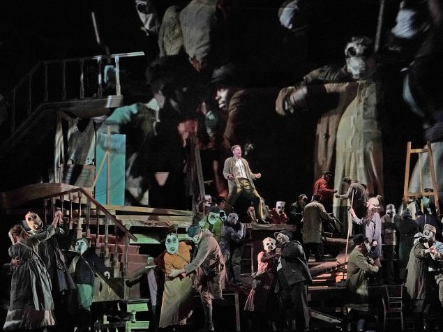 Peter Mattei among the gas-masked revelers in 'Wozzeck'.