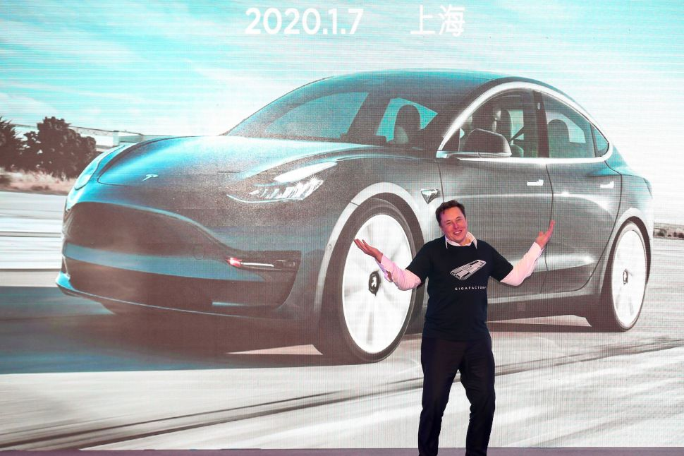 Tesla CEO Elon Musk gestures during the Tesla China-made Model 3 Delivery Ceremony in Shanghai on January 7, 2020.
