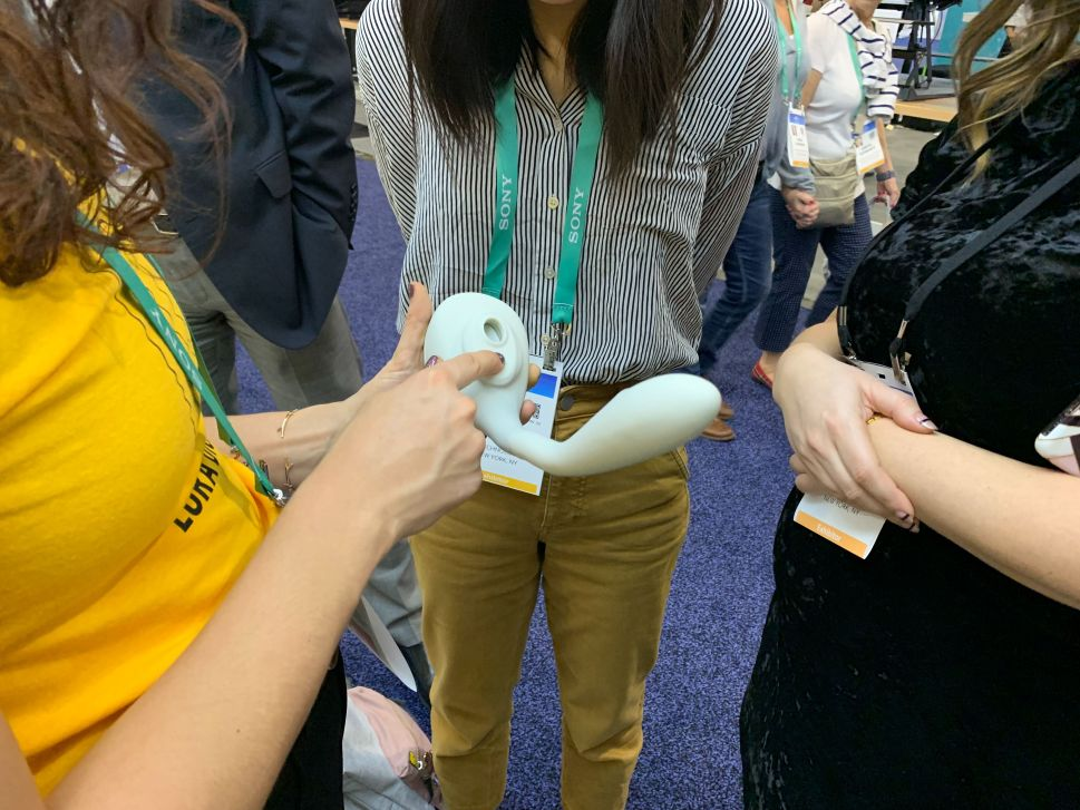 A Lora DiCarlo employee demonstrates Osé to interested customers at CES 2020 on January 7, 2020 in Las Vegas.