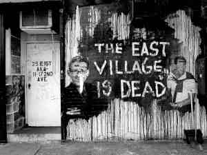 Graffiti laments the East Village's gentrification outside the former Mars Bar.