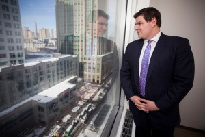 Tucker Reed, president of the Downtown Brooklyn Partnership, looking out of the window of the conference room at his offices at 1 MetroTech Center North