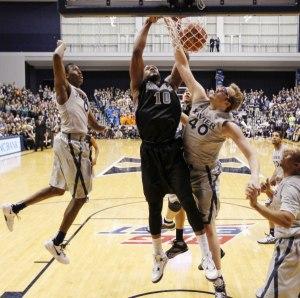 Providence forward Kadeem Batts (10) dunks on Xavier's Matt Stainbrook (40). (Credit: Frank Victores, USA TODAY)
