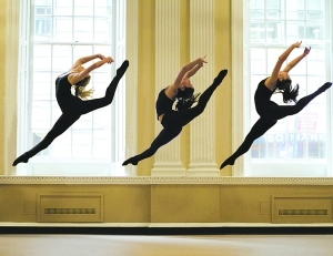 Dancers in the window at 140 William Street.