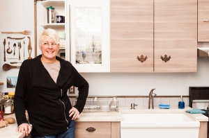 Manhattan BnB owner Anne Edris in her Avenue C BnB, which has recently been forced to close. (Emily Assiran)