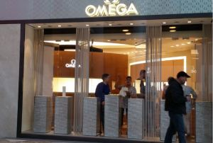 Workers finish setting up Omega in Brookfield Place yesterday in preparation for today's store opening (Photo: Lauren Elkies Schram).