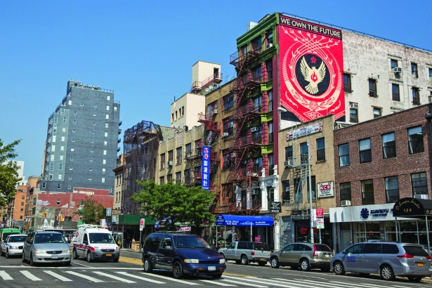 Artist Shepard Fairey Puts New Mural Up In Manhattan's Little Italy Neighborhood