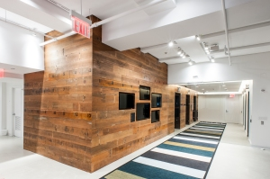 Teach for America's new reception area includes digital screens to display its core values.