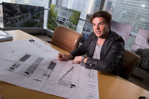 Danish architect Bjarke Ingels talks about his design for 2 World Trade Center in Larry Silvertrein's office in New York, U.S., on Friday, June 12, 2015.  Photographer: Michael Nagle