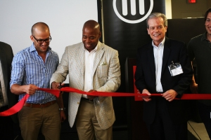 Brooklyn Borough President Eric Adams (with scissors) and Makerbot CEO Jonathan Jajlom (to his left) cutting the ribbon on the new factory (Photo: Brady Dale/Commercial Observer).